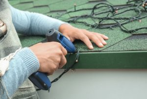 When hanging holiday lights on your home, use light clips from the hardware store rather than staple guns or the like, which can cause roof damage on your Chattanooga home.